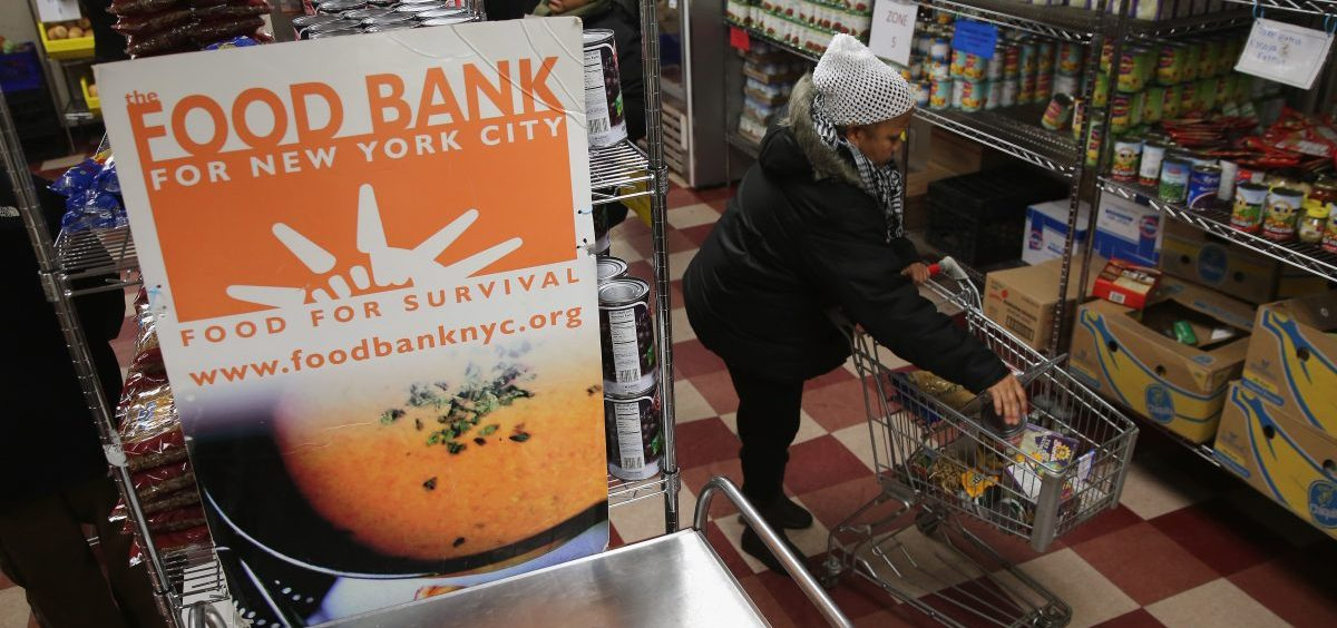 Harlem residents choose free groceries at the Food Bank For New York City in 2013. A number of new rules and actions proposed by the Trump administration could affect poor or low-income people who take advantage of government safety net programs.