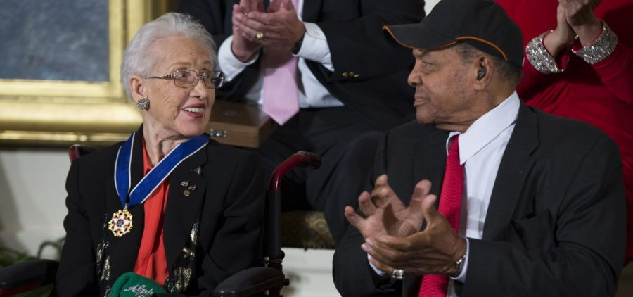 FILE - In a Nov. 24, 2015 file photo, Willie Mays, right, applauds NASA mathematician Katherine Johnson, after she received the Presidential Medal of Freedom from President Barack Obama during a ceremony in the East Room of the White House.