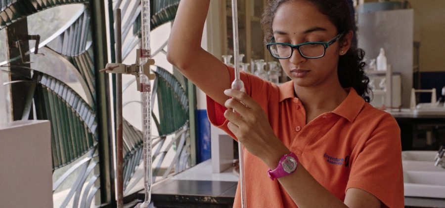 young woman student working in science lab