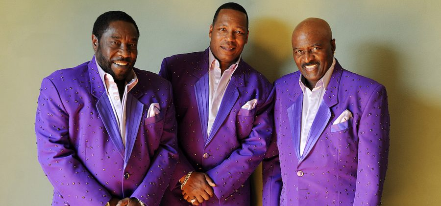 The band The O'Jays in matching purple jackets