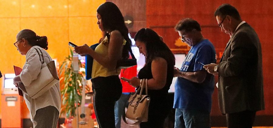 Job applicants wait in line at the Seminole Hard Rock Hotel & Casino Hollywood during a job fair in Hollywood, Fla., on Thursday.