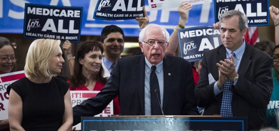 """Sens. Kirsten Gillibrand, D-N.Y., Bernie Sanders, I-Vt., and Jeff Merkley, D-Ore., conduct an event to introduce the """"Medicare for All Act of 2019"""" in Dirksen Building on Wednesday, April 10, 2019."""