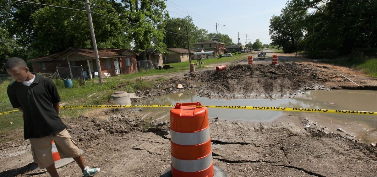 Water that came under a levee in Greenville, Miss., in 2011 caused this street to collapse. The city has had major floods twice since then, including record-breaking high water this year. Greenville's mayor says many residents live in low-lying areas served by outdated infrastructure.