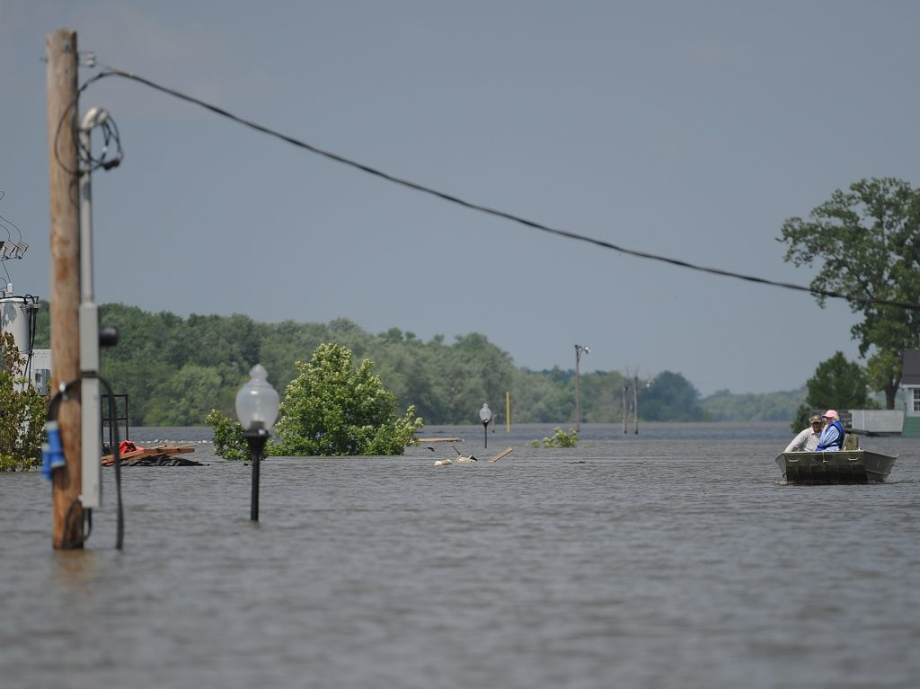 Boats on a street in Grafton, Ill., in June 2019 after the Mississippi River flooded part of the town.