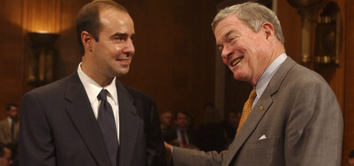Eugene Scalia (left) talks with Missouri Sen. Kit Bond before Scalia's confirmation hearing to be solicitor of the Labor Department in 2001.