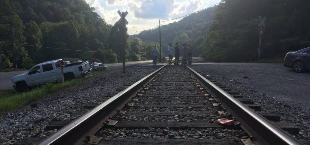 Miners assemble on railroad tracks to block a shipment of coal from a Blackjewel mine.