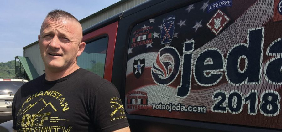 Richard Ojeda talks outside his campaign headquarters in Logan, W.Va. Ojeda is decorated with military medals and 26 tattoos and can bench presses 300 pounds. The retired Army paratrooper doesn't fit the typical profile of the ideal candidate for Congress.