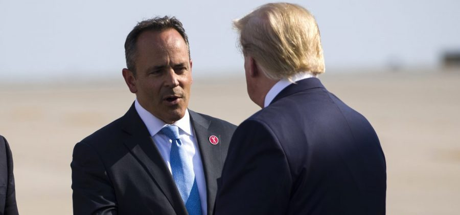 In a Thursday, Aug. 1, 2019 file photo, Gov. Matt Bevin, R-Ky., greets President Donald Trump as he steps off Air Force One at Cincinnati/Northern Kentucky International Airport, in Hebron, Ky., to speak at a campaign rally in Cincinnati.