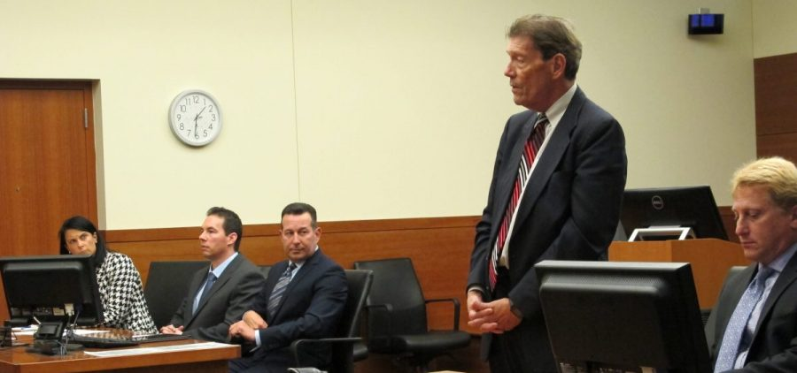 Franklin County Prosecutor Ron O'Brien speaks during a court hearing for defendant William Husel, second from left, as defense attorneys Diane Menashe and Jose Baez and assistant prosecutor James Lowe listen on Wednesday, Aug. 28, 2019, in Columbus, Ohio.