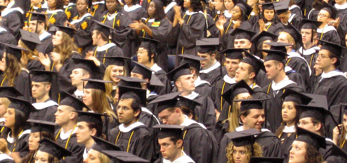 group of students in cap & gown at graduation ceremony