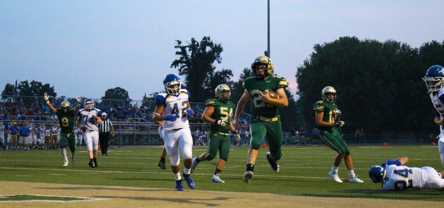 Athens player runs with football.