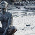 PBS Show POV Grit Documentary - man sitting in Mud