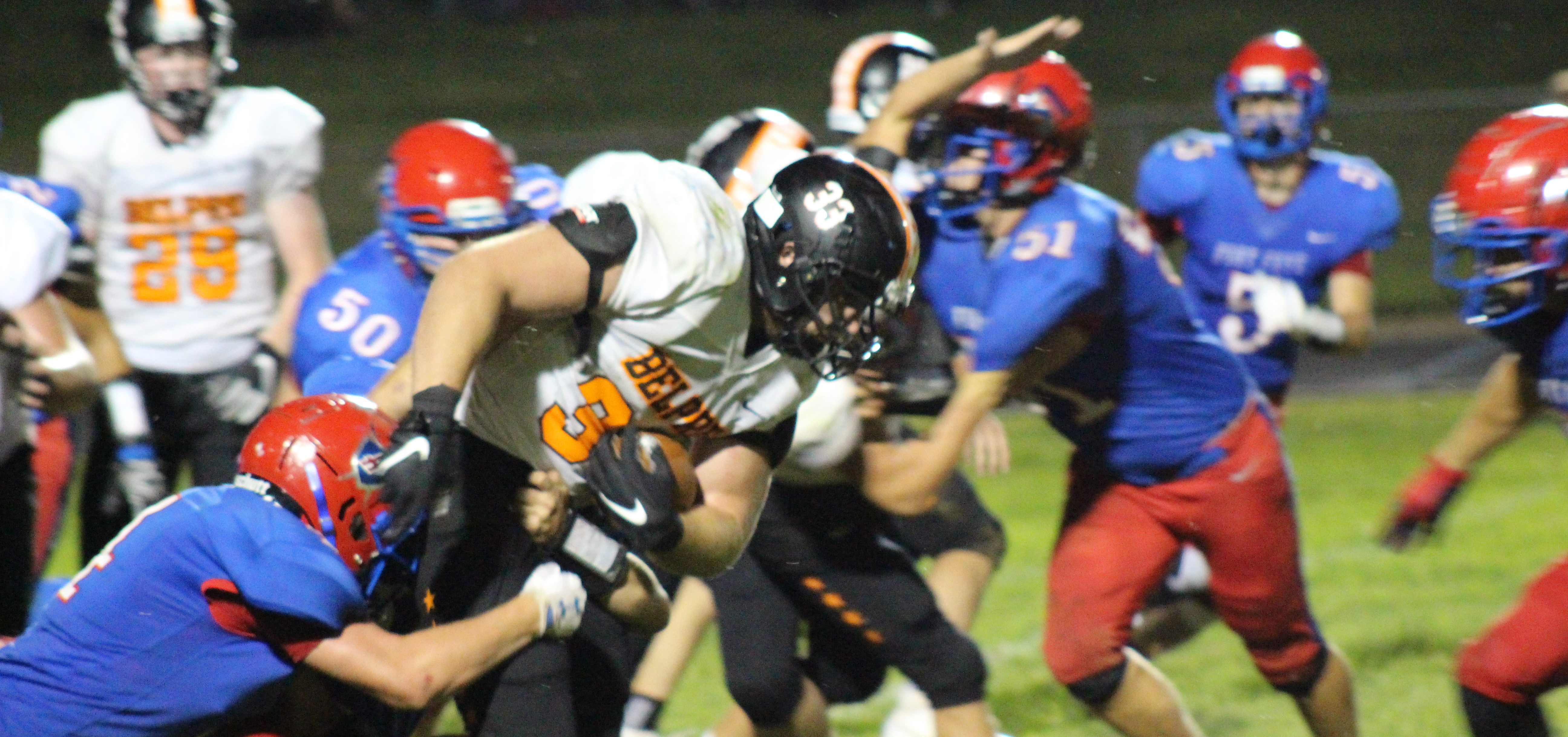 Belpre back fights through tackle