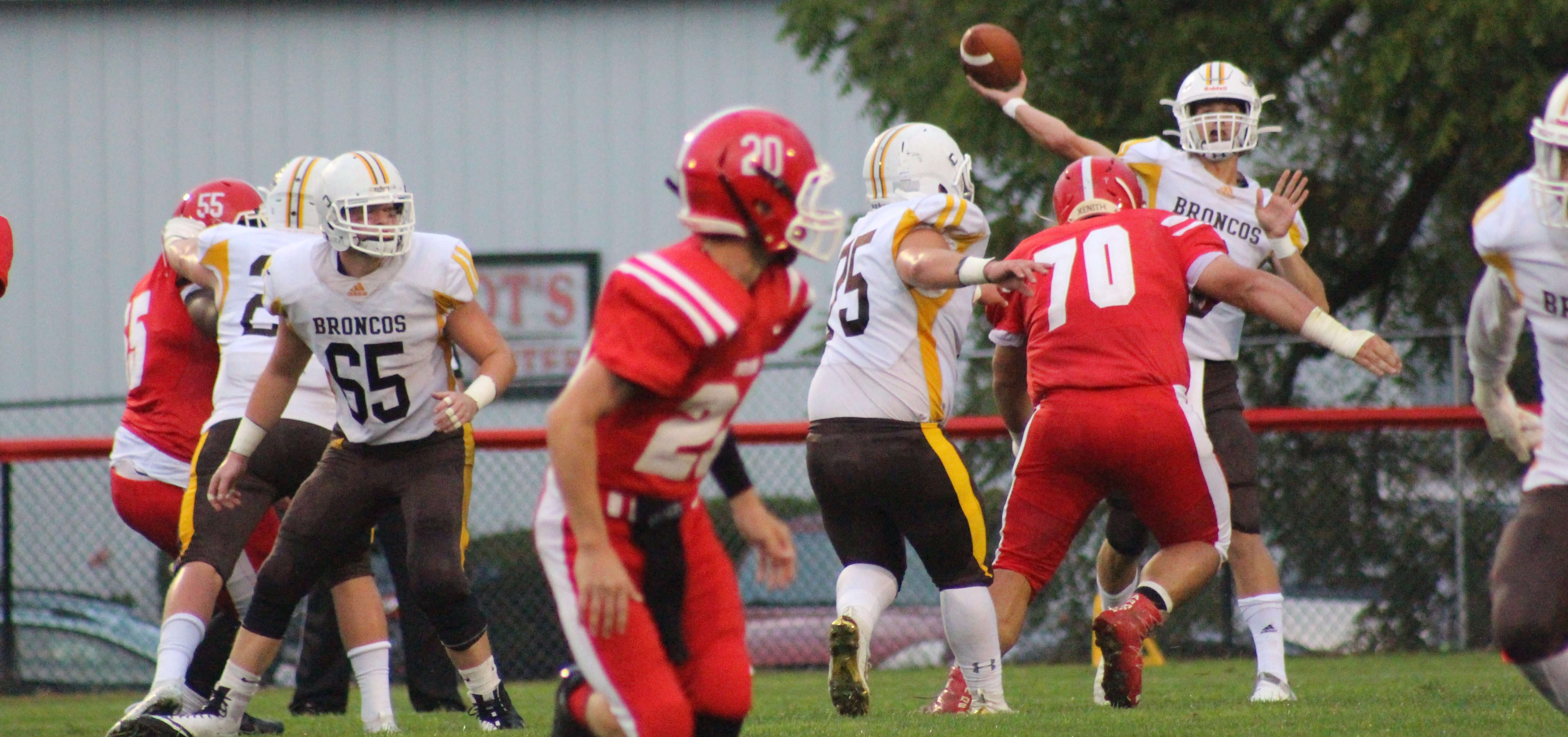 Western Brown quarterback launches a pass