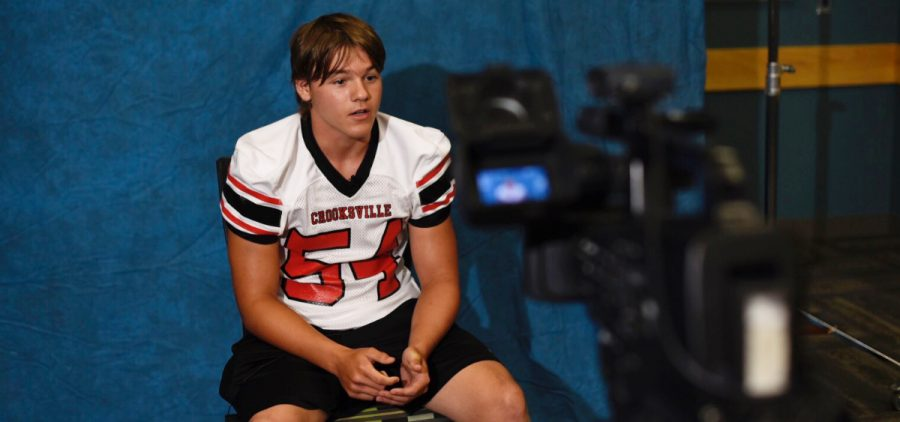 Crooksville player gets interviewed by reporter.