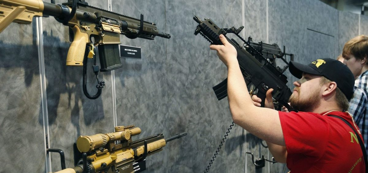 A visitor peruses H&K rifles at the SHOT Show in Las Vegas. Such weapons were once restricted under a 1994 ban that expired with changing politics in the United States.