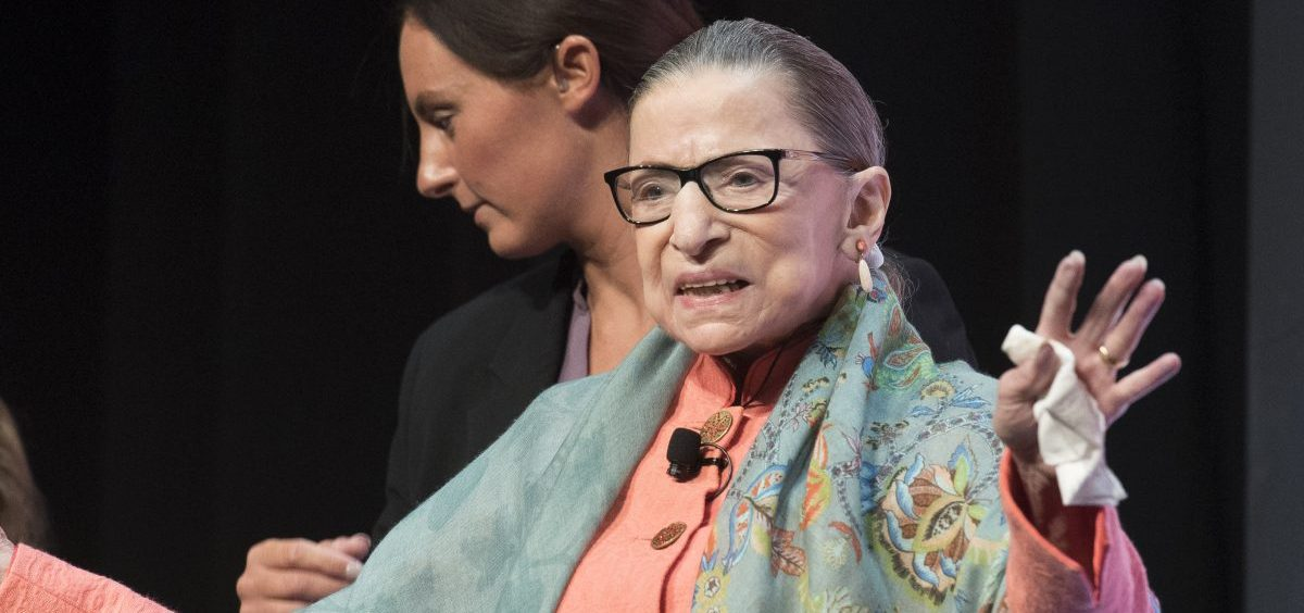 Justice Ruth Bader Ginsburg waves to the crowd at the Library of Congress National Book Festival on Saturday.