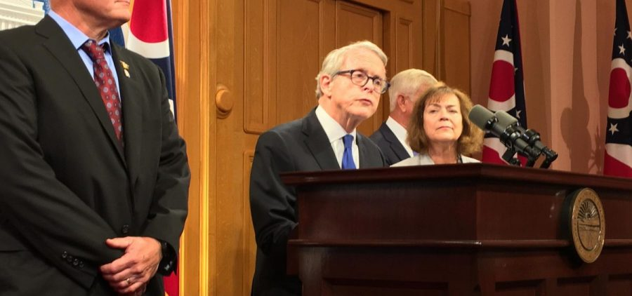 Gov. Mike DeWine speaks to reporters
