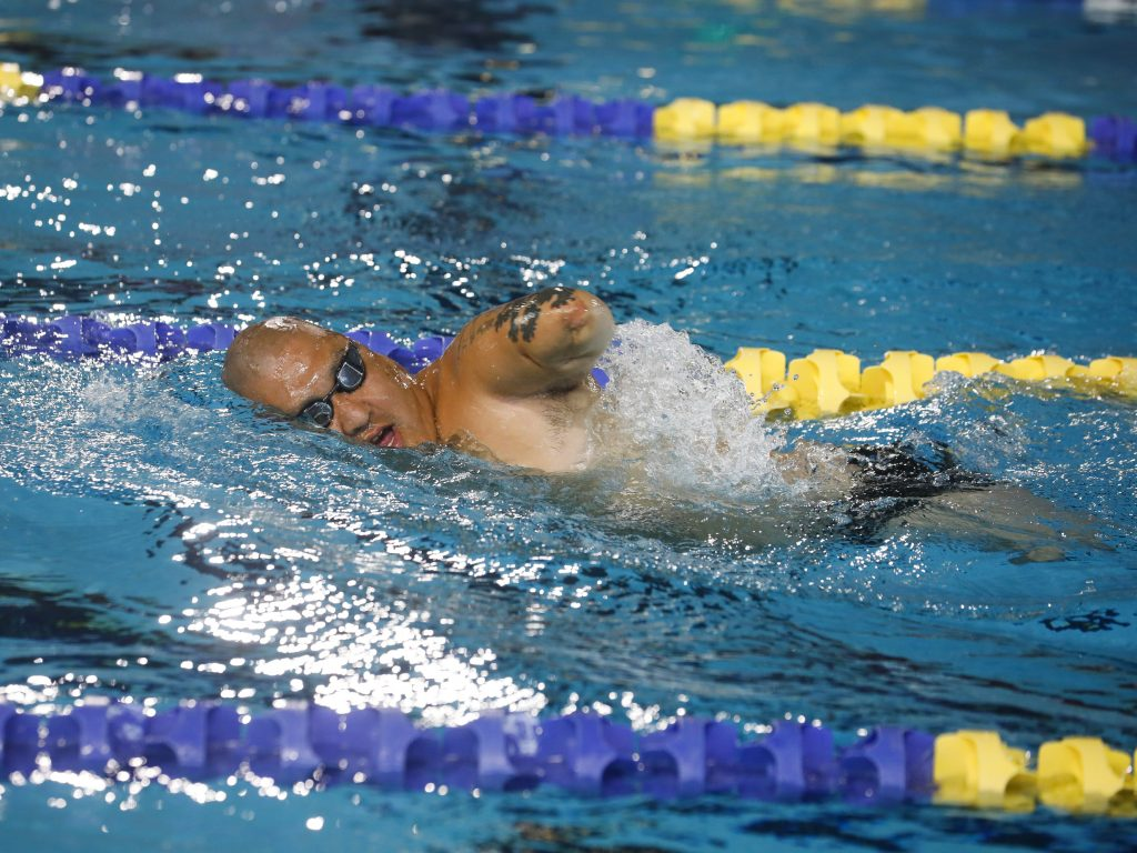 Matt swims during the Warrior Games. He and Alicia live in North Carolina and traveled to the Tampa Bay area so he could compete in several athletic events throughout the week. He competed in sitting volleyball, swimming and indoor rowing.