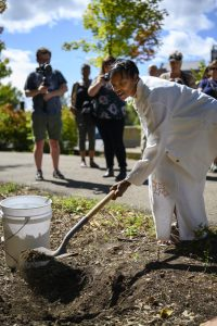 College of Health Sciences & Professions Chair Dr. Jennifaye Brown collects soil during the Christopher Davis Memorial last Saturday, September 14, 2019 in Athens, Ohio. Part of the ceremony was dedicated to collecting soil to be sent to the Legacy Museum and Memorial in Montgomery, AL. (Evann Figueroa/WOUB)