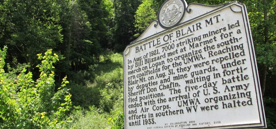 In this June 6, 2011 photo, this historical marker along W.Va. Route 17 in Blair, W.Va., is the only visible sign of the 1921 battle here between thousands of armed, unionizing coal miners and the thousands of law enforcement officers and security guards hired to defeat them. At least 16 men died on the mountain