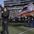 In this Dec. 24, 2016 file photo, Eddie Money performs the national anthem before an NFL football game between the Oakland Raiders and the Indianapolis Colts in Oakland, Calif.