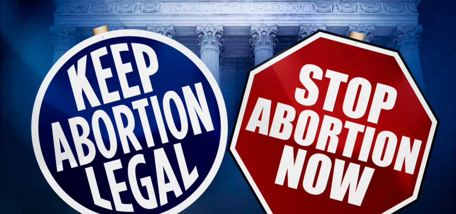 Signs argue both sides of the abortion debate