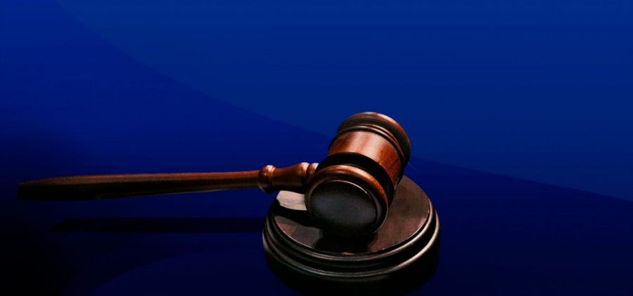 graphic of a gavel on a blue background