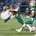 Athens player makes a crushing tackle