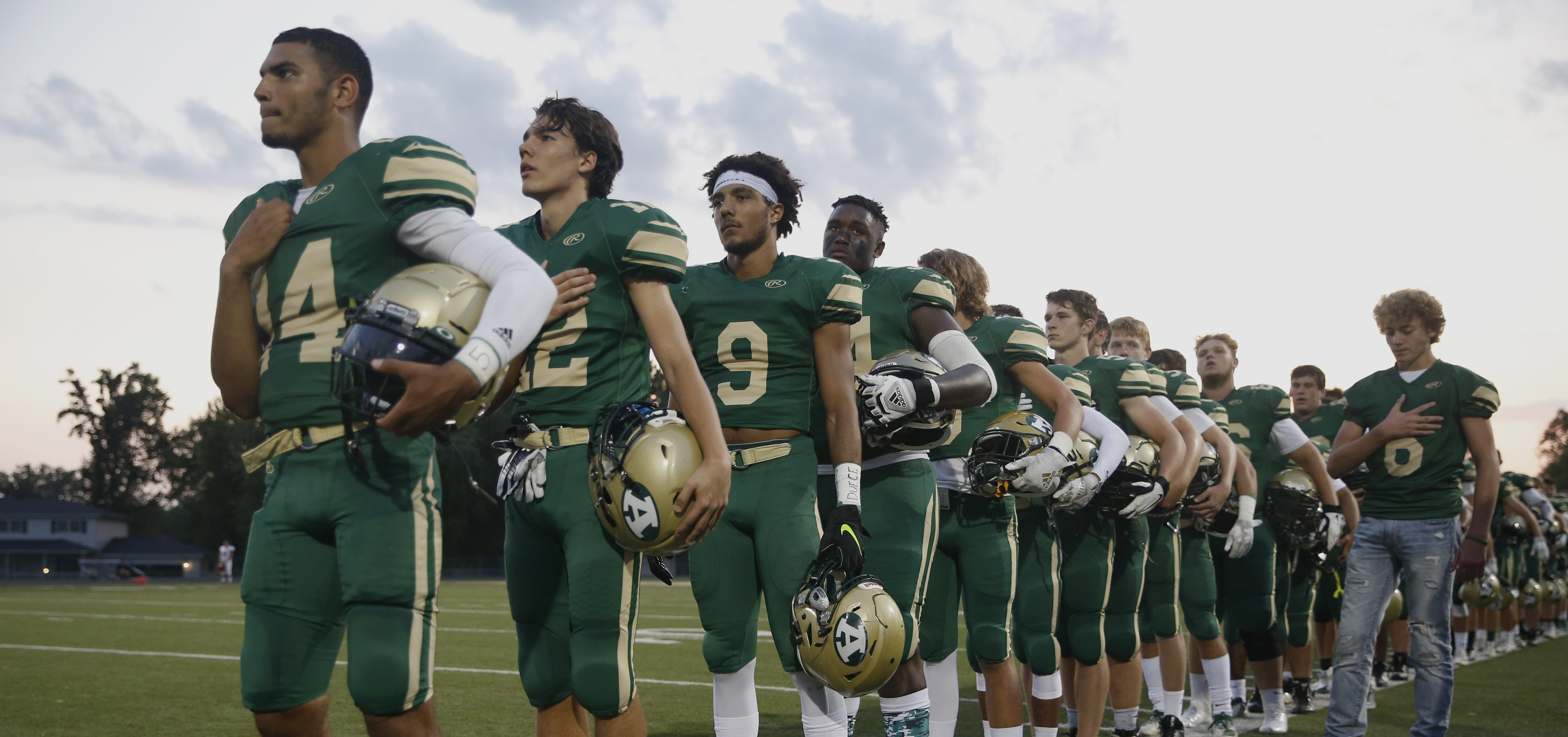 Players of Athens Bulldogs lines up for the national anthem before the game against Alexander Spartans at Athens High School on Sep 20, 2019.