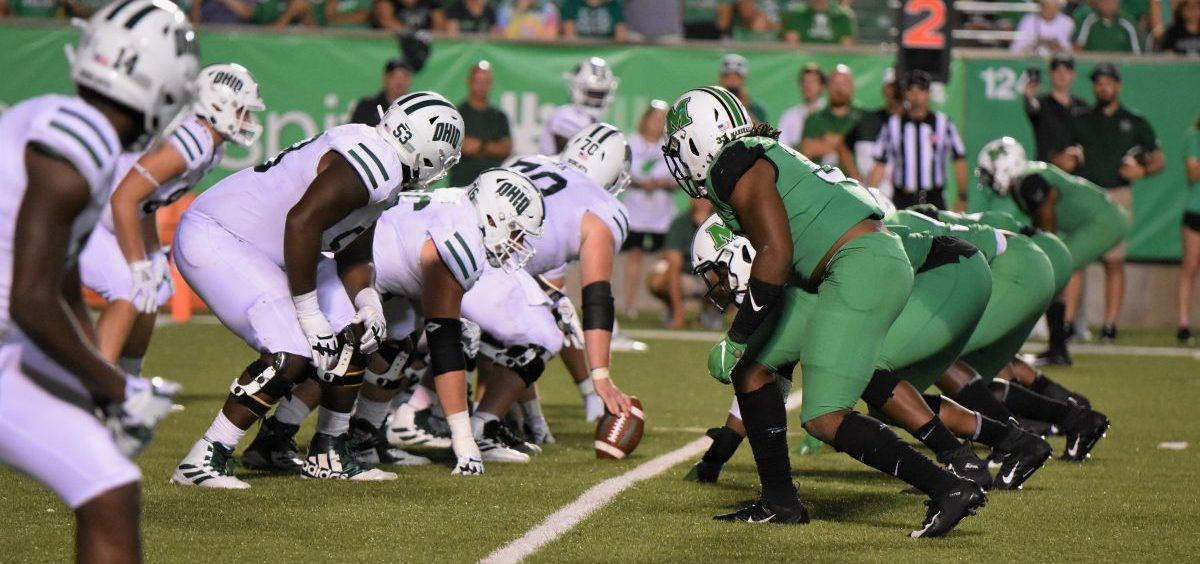 The Ohio University Bobcats line up for a snap against the Marshall Thundering Herd