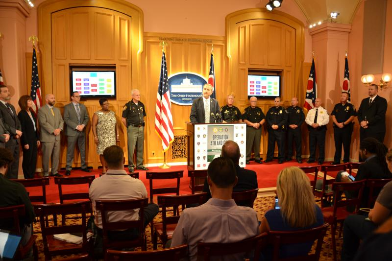 Ohio Attorney Gen. Dave Yost and representatives of agencies involved in sting