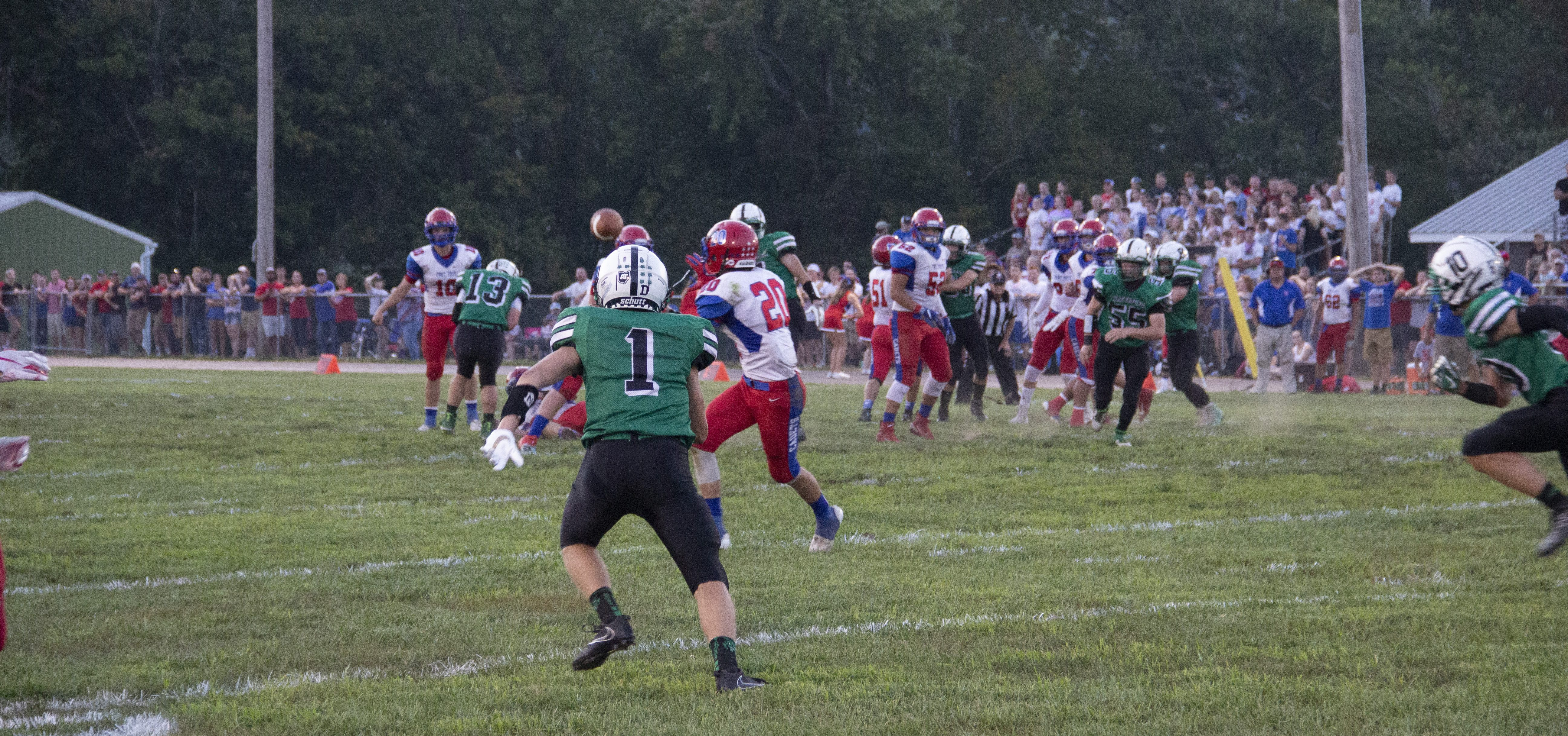 Waterford player watches Fort Frye player receive a pass
