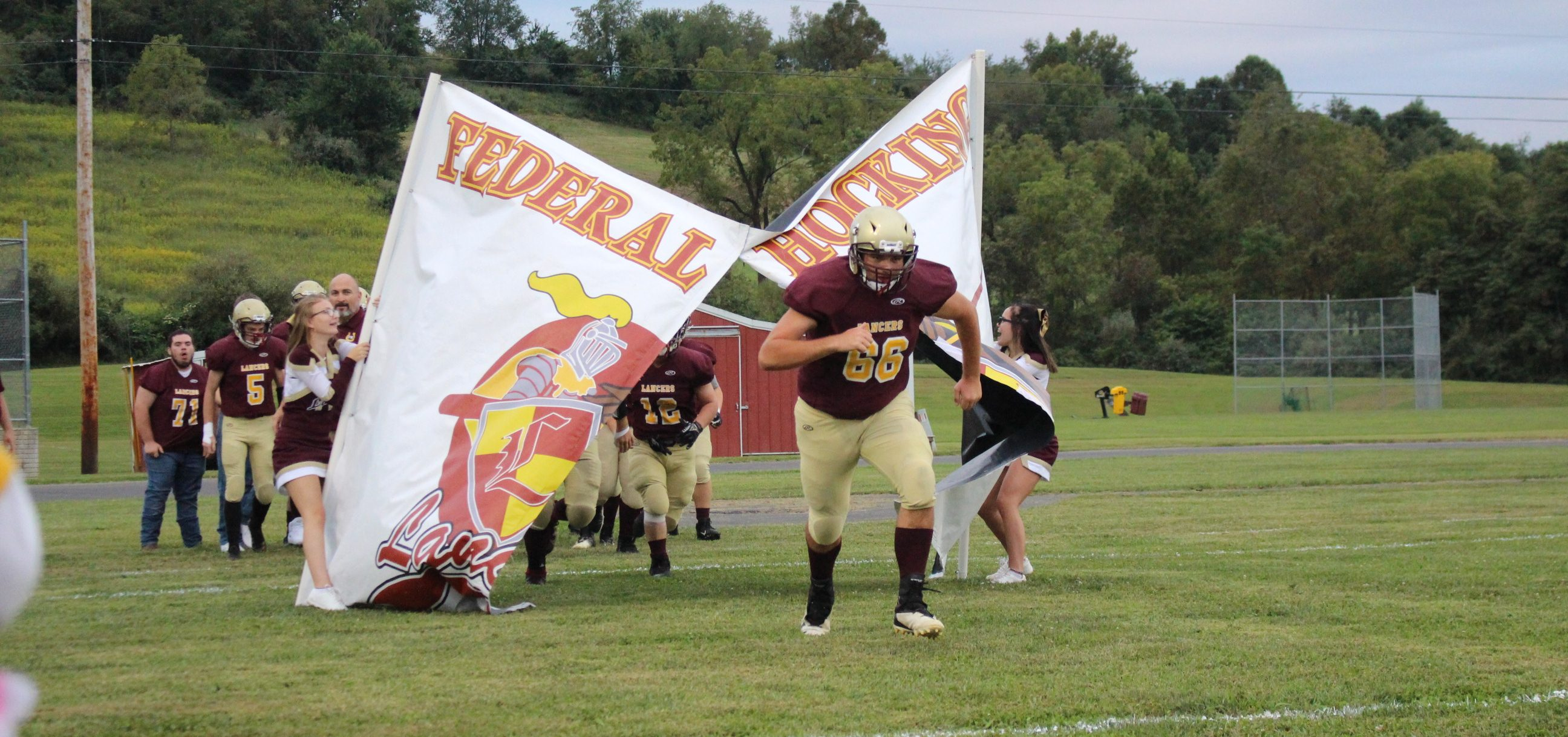 Federal Hocking player bursts through the banner
