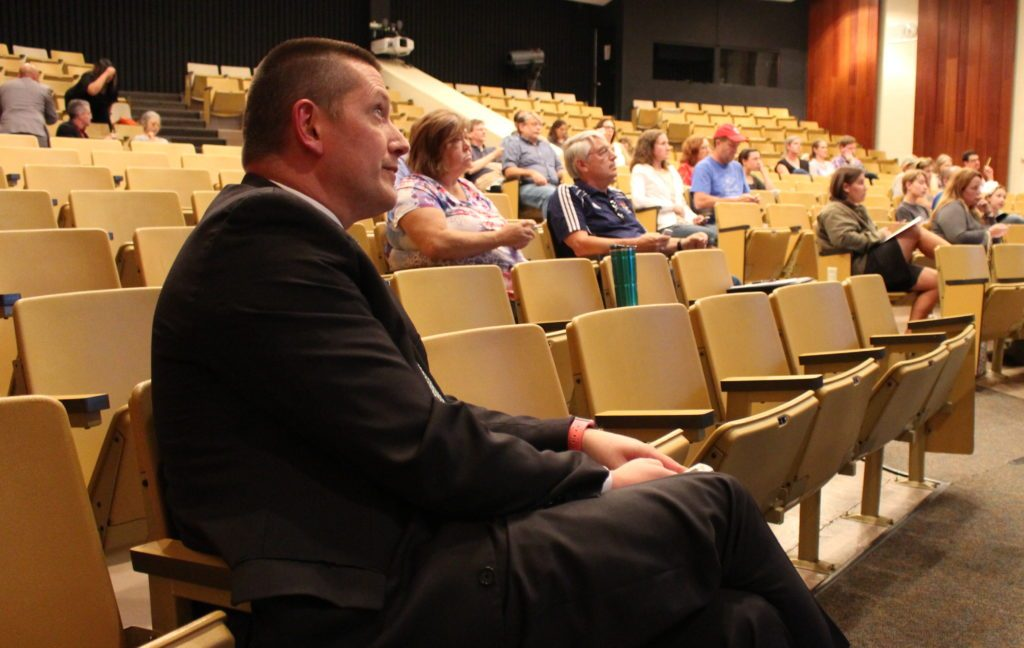 Superintendent Tom Gibbs sits in the crowd at a recent Athens City School District Board of Education meeting.