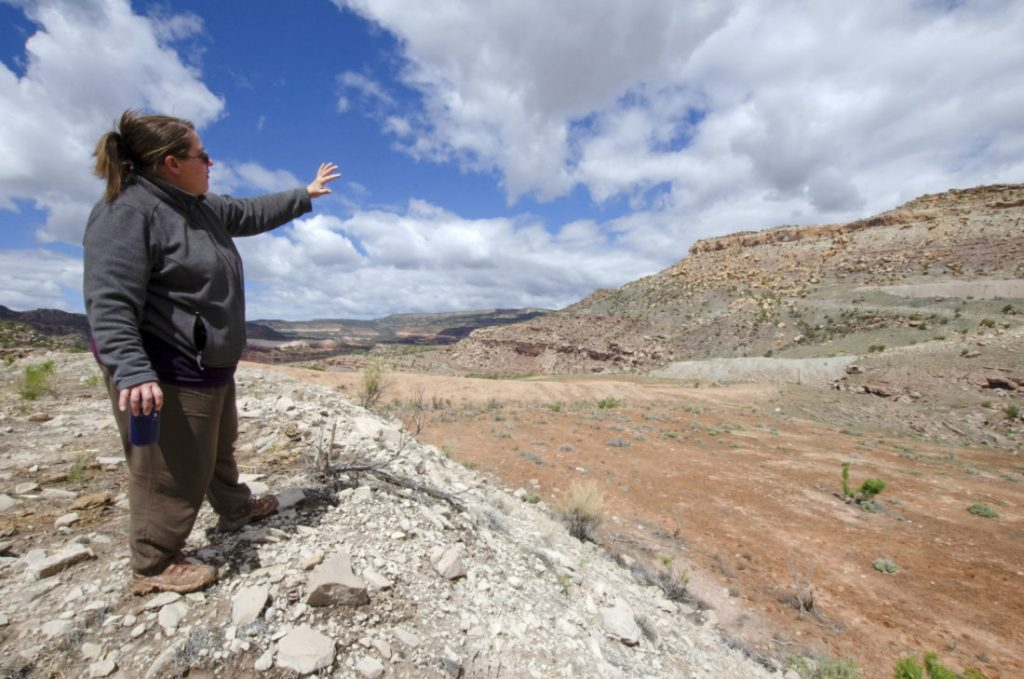 Jennifer Thurston, an activist with the Information Network for Responsible Mining, tours the long-idled Van 4 mine. She won a court ruling in July that called for cleanup to begin.