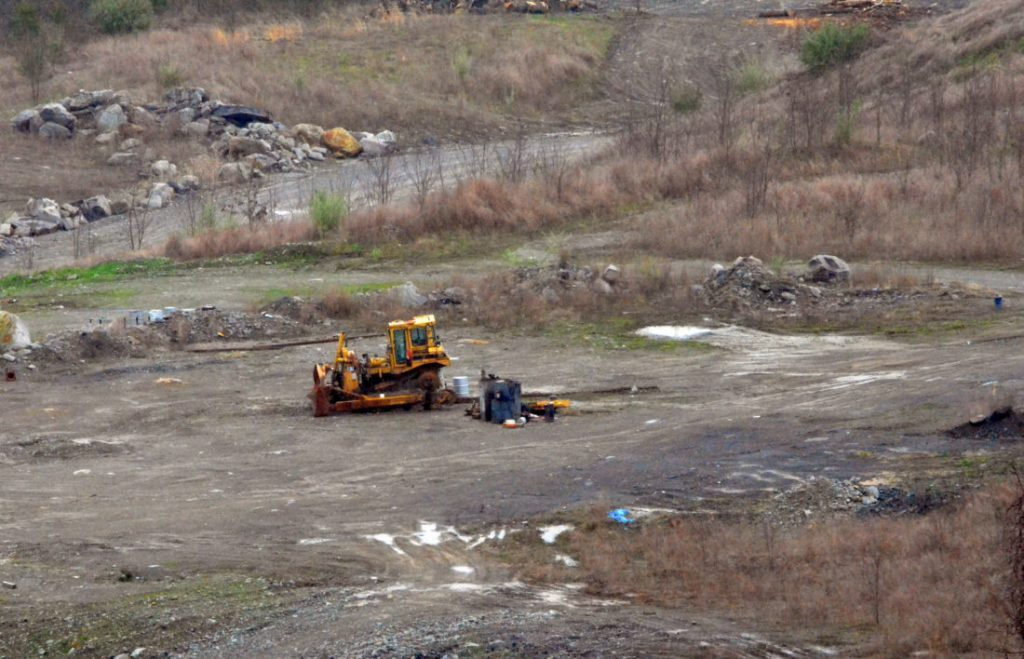 A broken down bulldozer rusts in 2018 on a Virginia strip mine owned by West Virginia Gov. Jim Justice and his family.