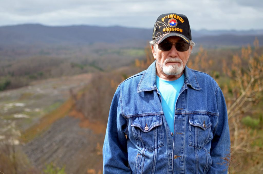 Larry Bush, a retired coal miner and mine inspector, grew up hunting squirrels on this hill near Keokee, Virginia, which was since stripped and has been only partially reclaimed by companies linked to the governor of West Virginia.