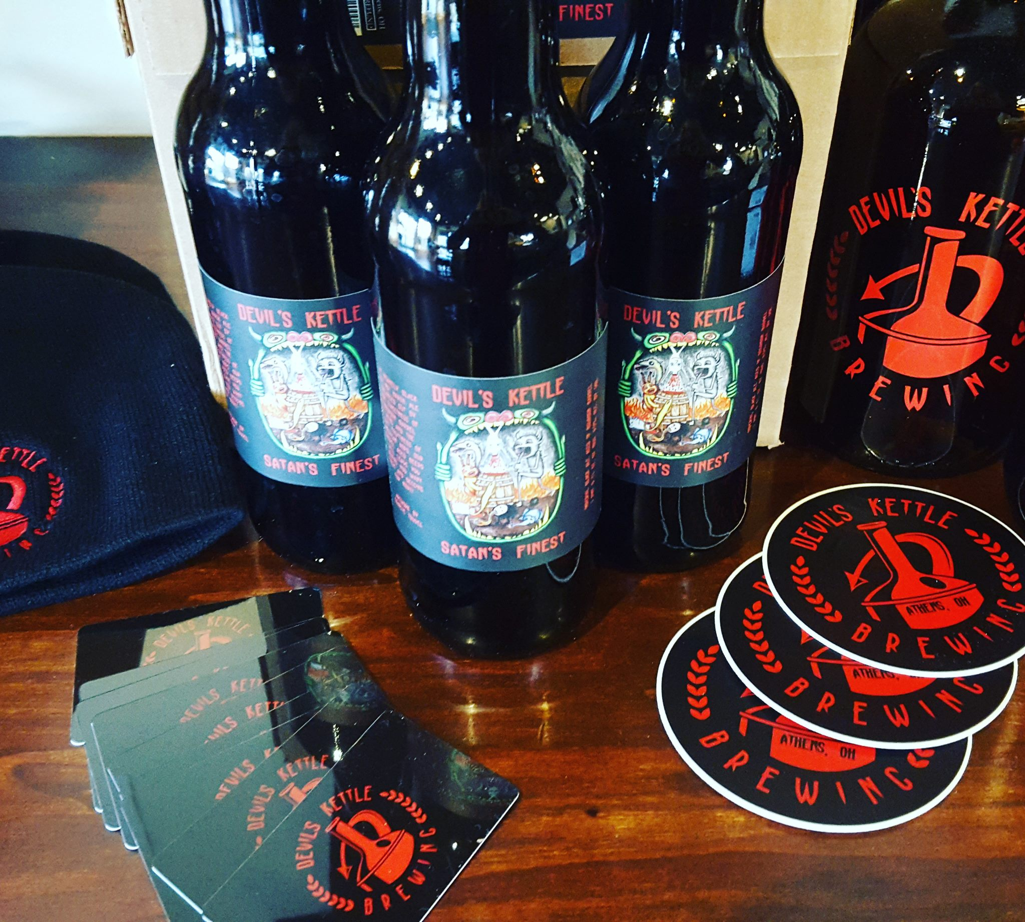 Devil's Kettle bottles and other merchandise on a table