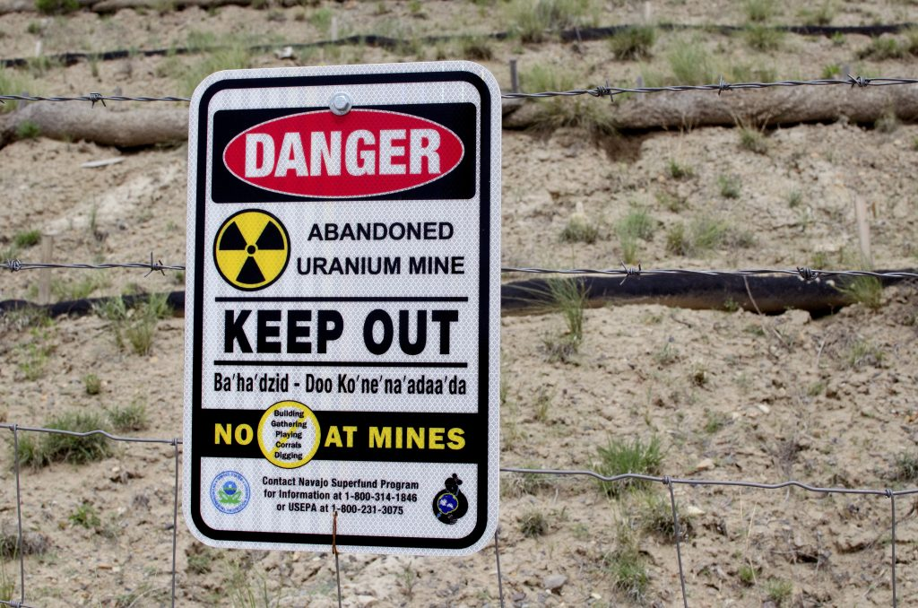 A sign warns of an abandoned uranium mine. Two such mines, in addition to a former mill site, surround the Red Water Pond Road Community in the Navajo Nation.