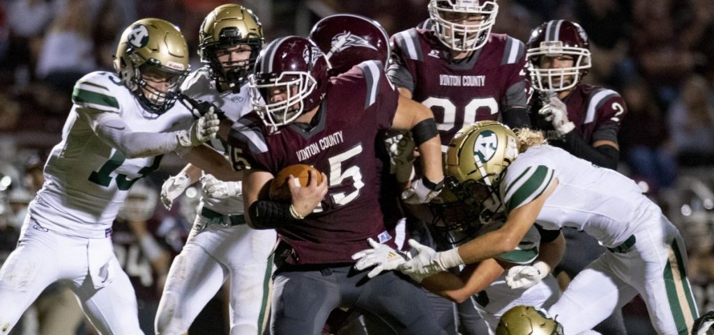 Vinton County senior Logan Baker fights through the defense during the game at Vinton County against Athens High School on Sept. 27, 2019