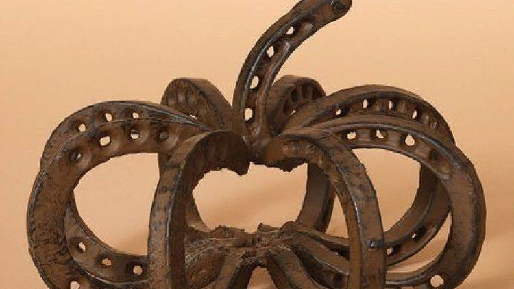 A welded horseshoe pumpkin