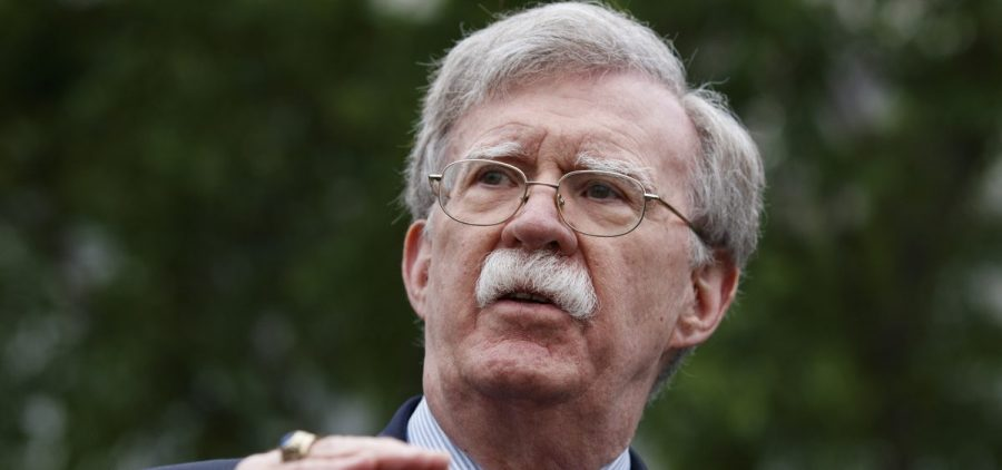 National security adviser John Bolton talked to reporters outside the White House. The hawkish former U.N. ambassador is stepping down.