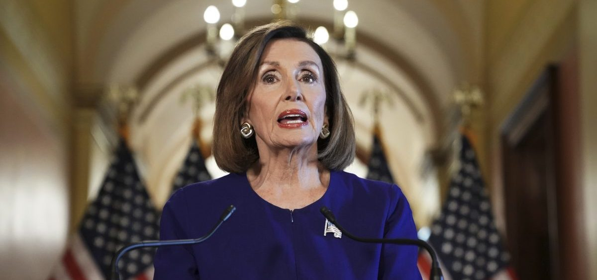 House Speaker Nancy Pelosi reads a statement announcing a formal impeachment inquiry into President Trump on Capitol Hill on Tuesday.