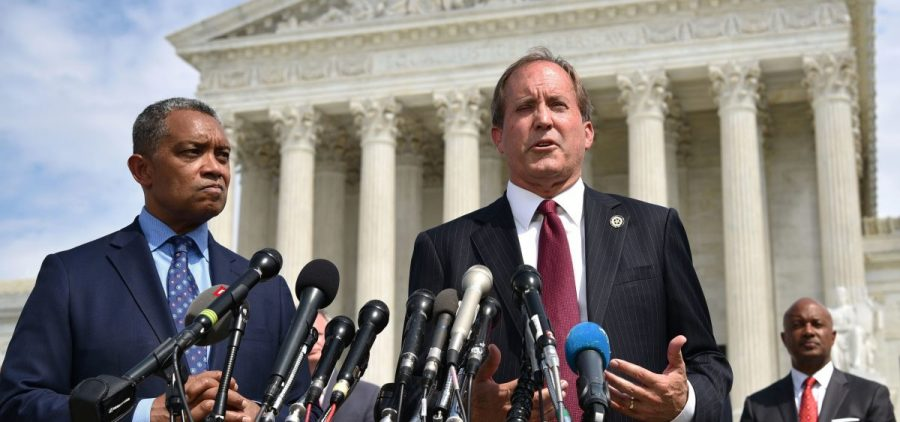 District of Columbia Attorney General Karl Racine (left) and Texas Attorney General Ken Paxton speak Monday about the launch of an antitrust investigation into Google outside the Supreme Court in Washington, D.C.