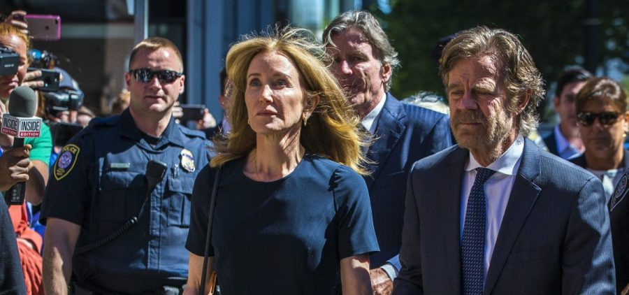 Actress Felicity Huffman and her husband, actor William H. Macy, arrive for her sentencing hearing Friday at the John Joseph Moakley United States Courthouse in Boston.