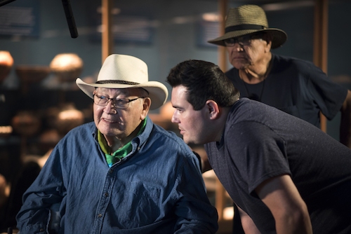 native american cowboy speaking with film director