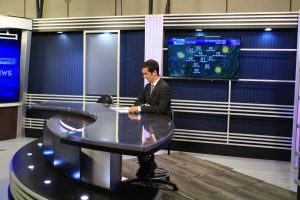 Student getting ready to anchor on new Newswatch set