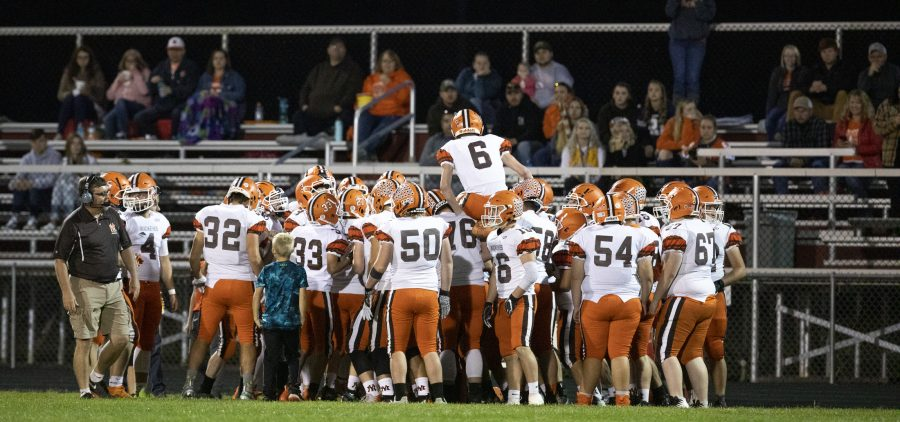 Nelsonville-York High Schools Christopher McDonald (6) is hoisted up by his team a game between Nelsonville-York and Meigs on Oct. 4, 2019 at Meigs High School in Pomeroy, Ohio. PHOTO: Charles Hatcher/WOUB
