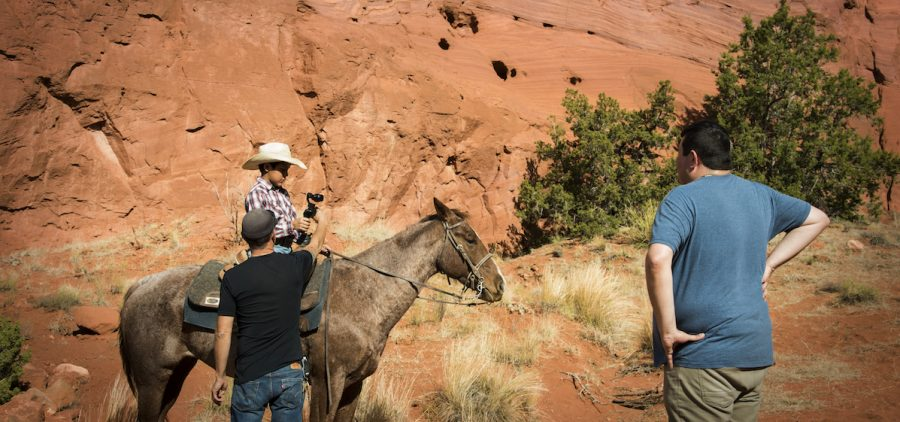 native American cowbiy on horse i front of Arizona mountains